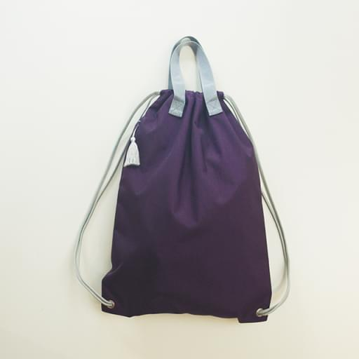 knappack with tassel/purple